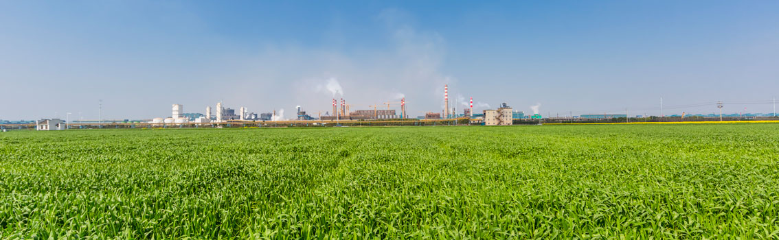 Industrial zone - surrounded by green gras and blue sky